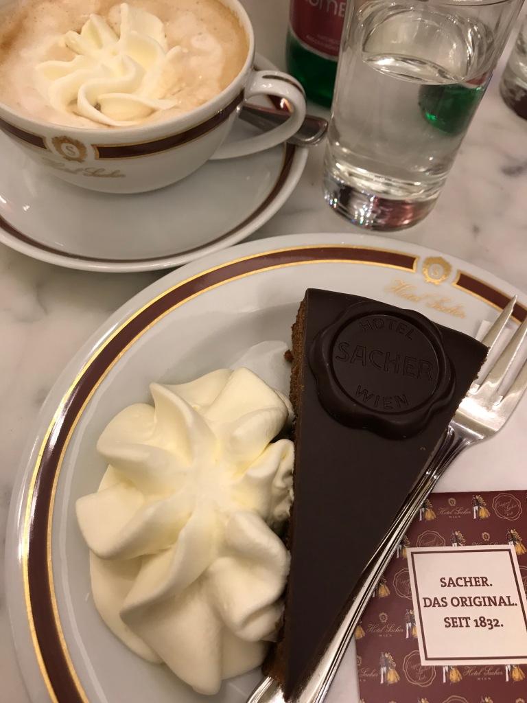 Sachertorte chocolate cake with whipped cream at Hotel Sacher in Vienna