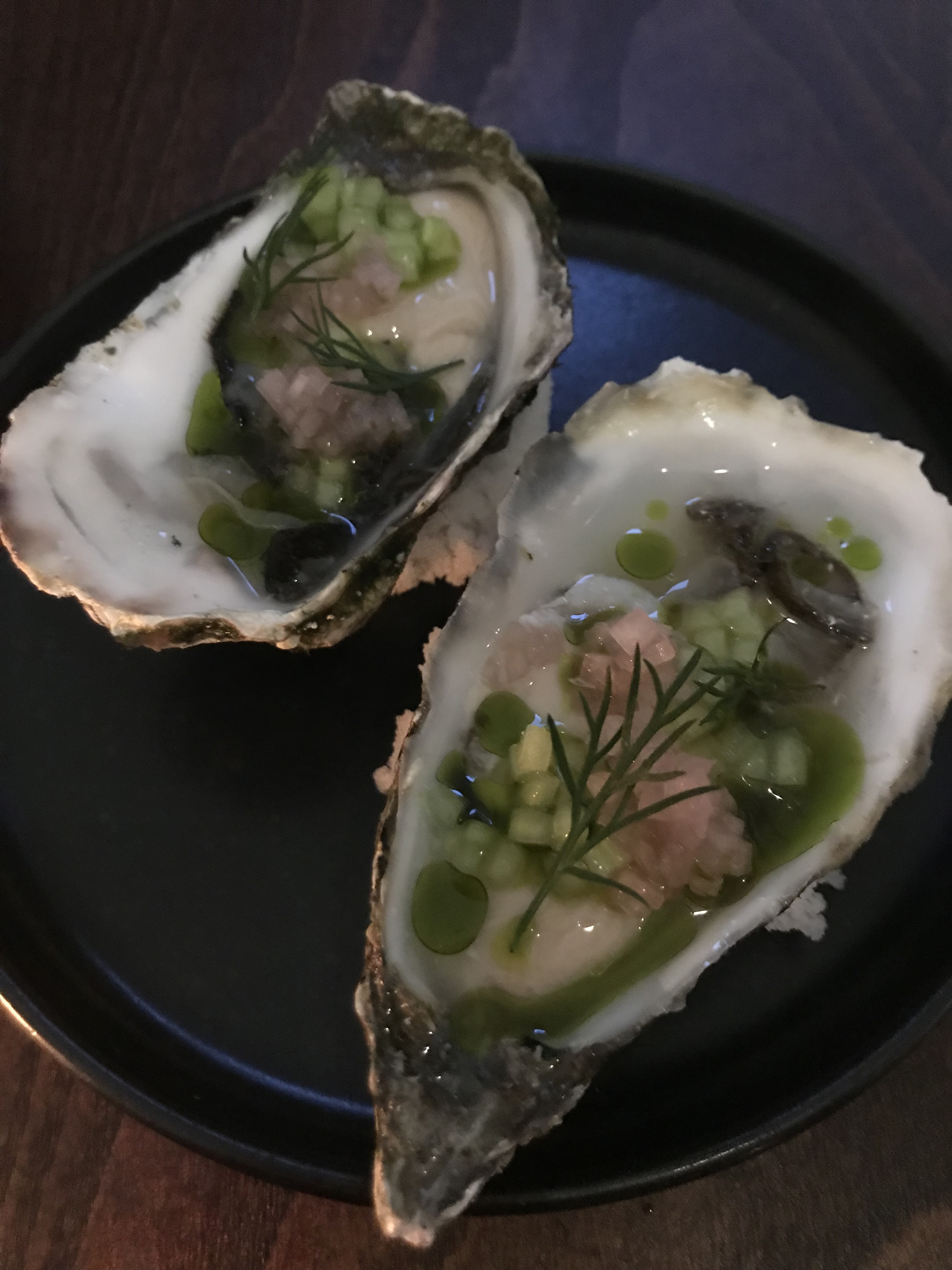 Open face oyster with dill, herbs, and dressing