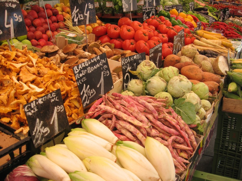 rows of fresh produce and signs