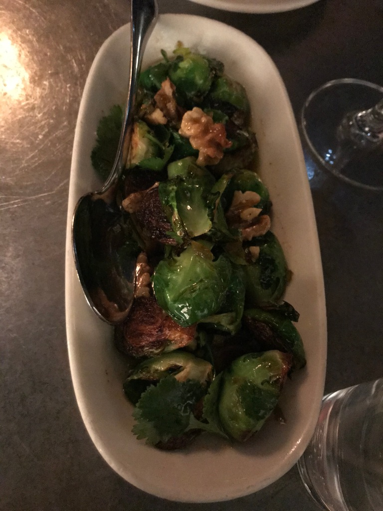 brussels sprouts and walnuts in a white dish