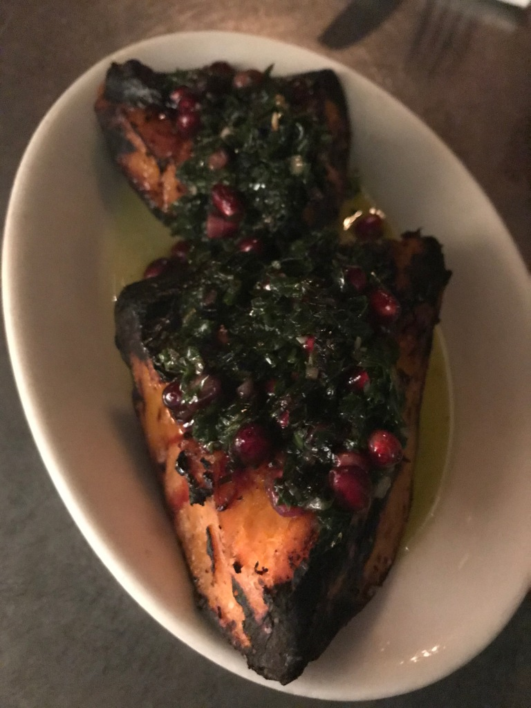 grilled orange kabocha squash, pomegranate arils, mint pesto