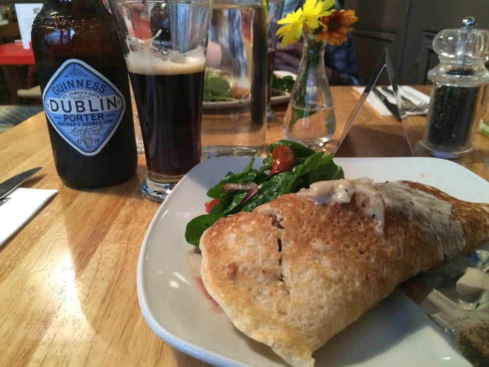 Irish boxty potato pancake, green salad, glass of porter beer