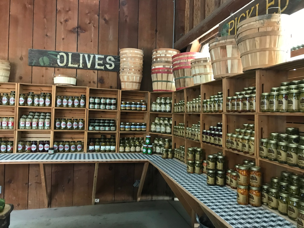 Market stand with jars of olives